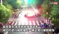 闯红灯逆行还带着孩子!监拍年轻妈妈路口撞上小轿车负全责